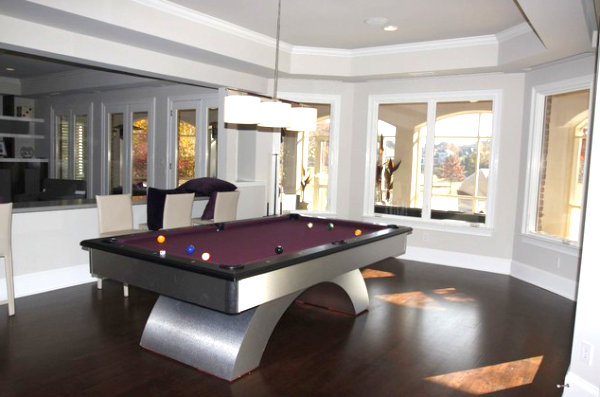Purple pool table in a family room
