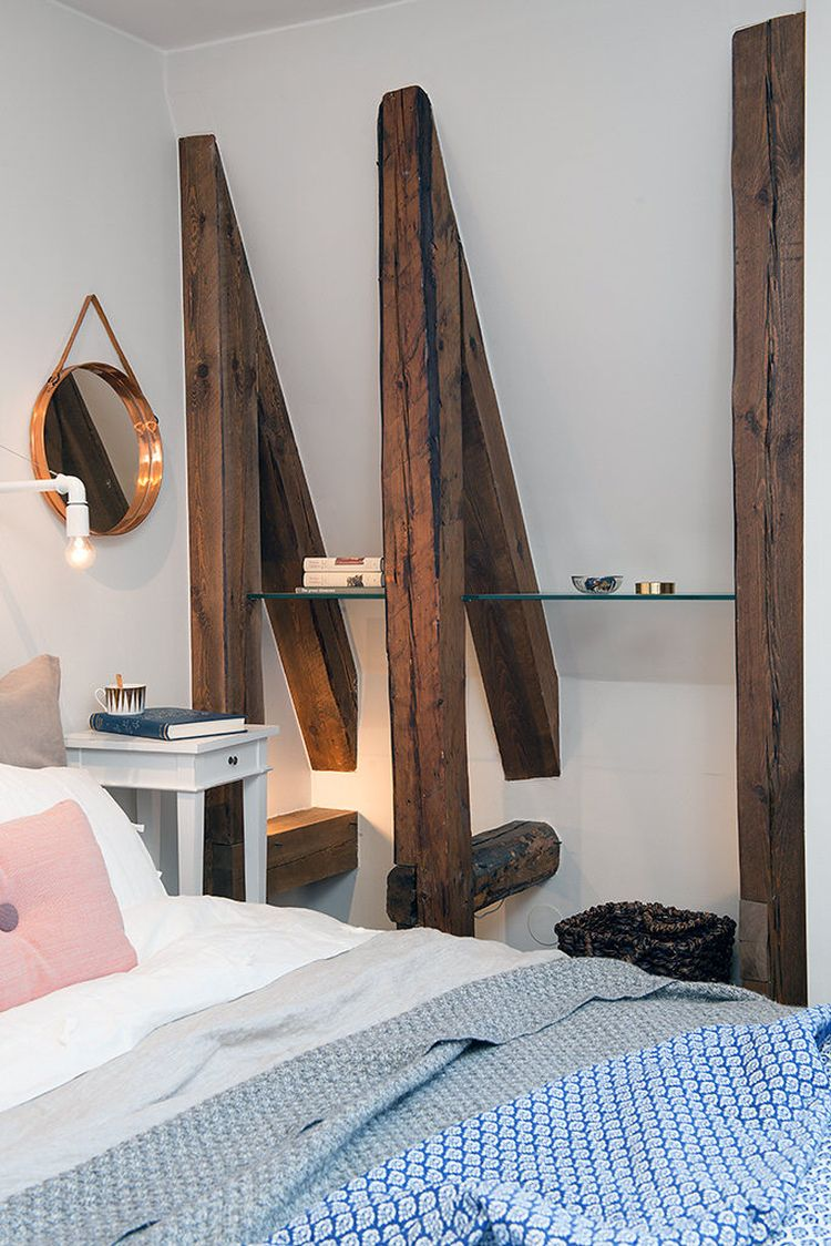 Rustic exposed wooden beams in the bedroom