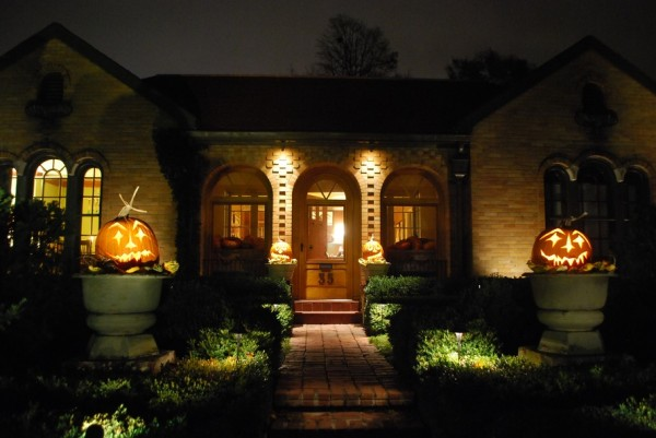 Scary path and with Halloween pumpkins and well-lit entry