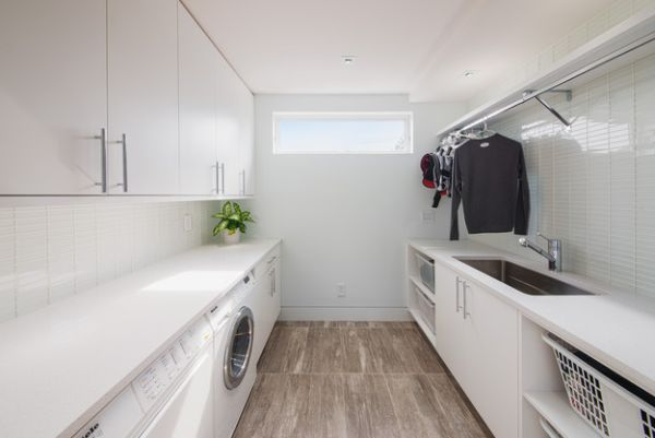 Sleek and stylish all-white contemporary laundry room!