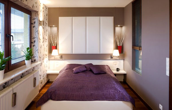 Smart lighting and sleek shelves create a refined bedroom