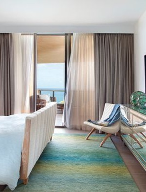 Subtle shades and the ocean view outside complete the coastal style in this stunning bedroom