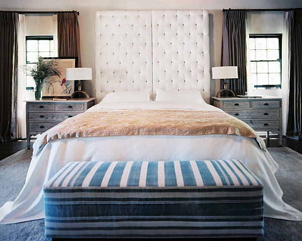Upholstered headboard in a cozy bedroom