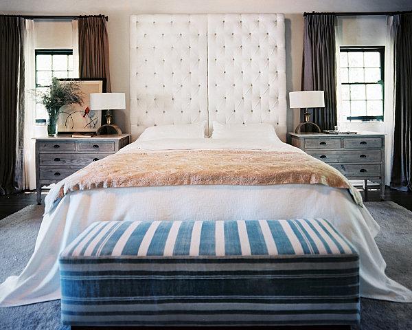 Upholstered headboard in a cozy bedroom