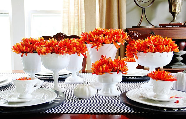 White and orange fall table setting