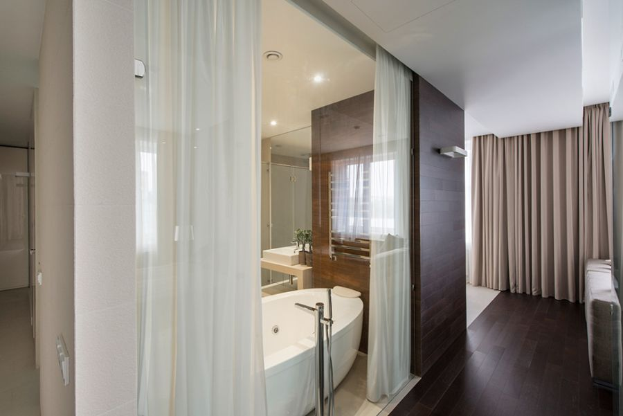White curtains for the shower and the bathtub