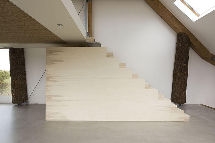 Wooden staircase leading to the bedrooms