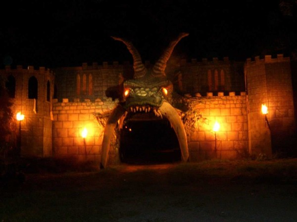 castle brightly lit outside with dark monster mouth entrance