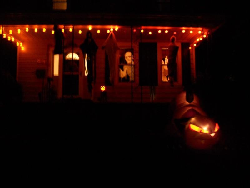 dark orange porch with bright figures in windows