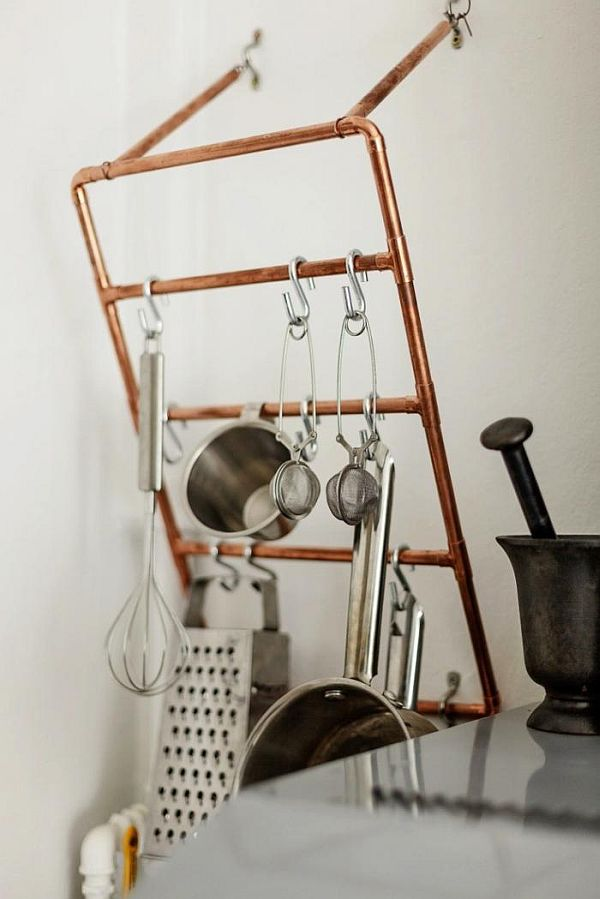exposed copper pipes as pot holder