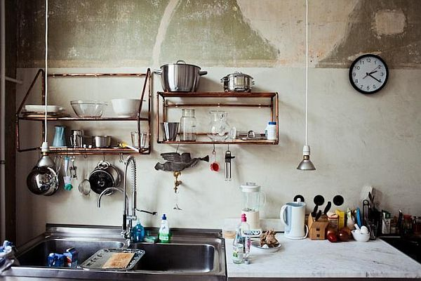 exposed copper pipes as shelves
