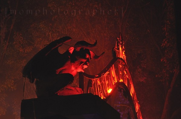 scary gargoyle lit with orange light