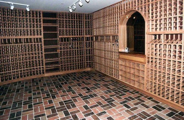 wine cellar in Petaluma California with earthtone tile floor and mirrored niche