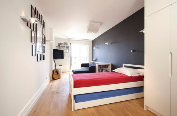 Accent wall adds color to the teen bedroom without visual fragmentation of space