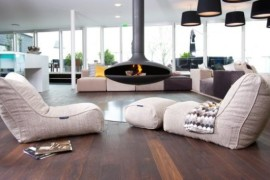 An orb fireplace and bean bag recliner chairs seem like an ideal fit for the bachelor pad