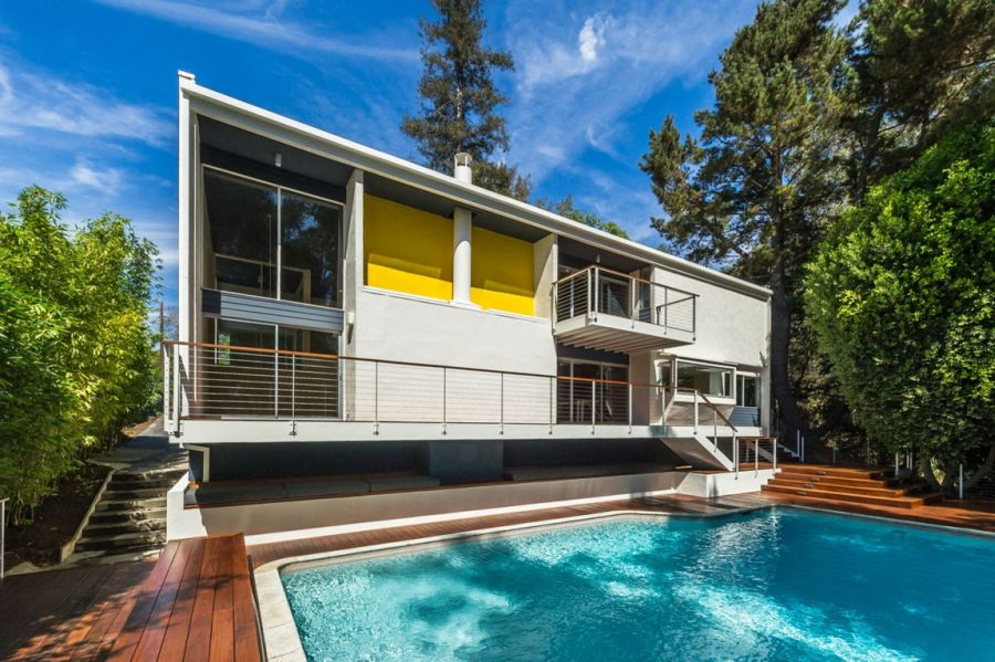Bakyard with wood deck and a pool Renovated LA Residence Inspired By Its Mid Century Modern Roots