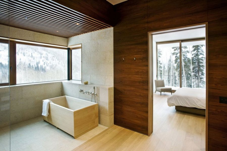 Bathroom with wooden walls and glass shower enclosure