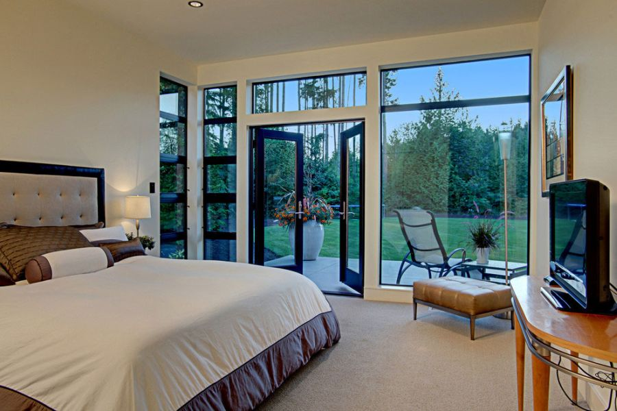 Beautiful bedroom connected with the green landscape