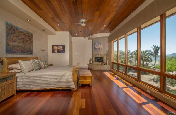 Beautiful bedroom with unabated views and a fireplace in the corner