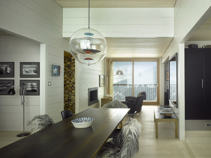 Beautiful pendant light above the table Idyllic Alpine Retreat Combines Stunning Scenery With Serene Solitude