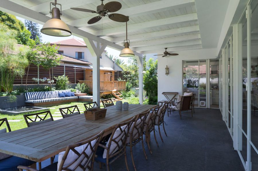Beautiful pergola with dining space connected to the backyard