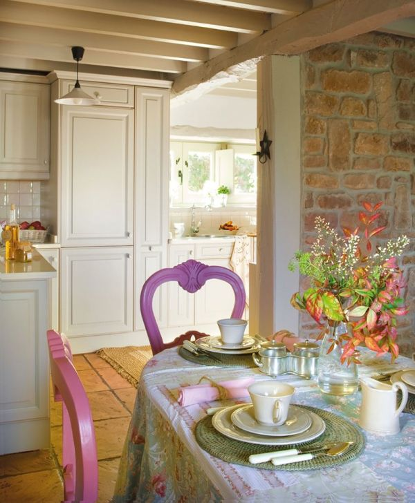 Beautiful purple and pink chairs at the dining table
