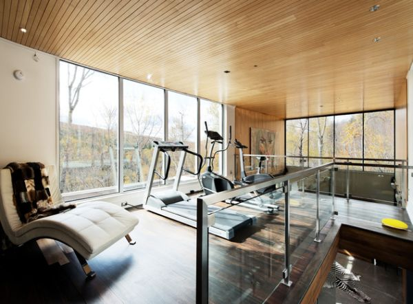 Beautiful wooden ceiling and the fabulous view outside add to the appeal of this home gym