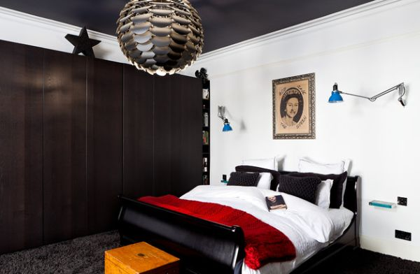 Bedroom with a black and white color scheme along with a dash of red