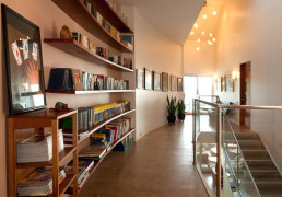 Bookshelves in a modern hallway