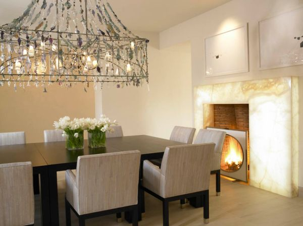 Brilliant dining room with fireplace lit from behind its quartzite slab