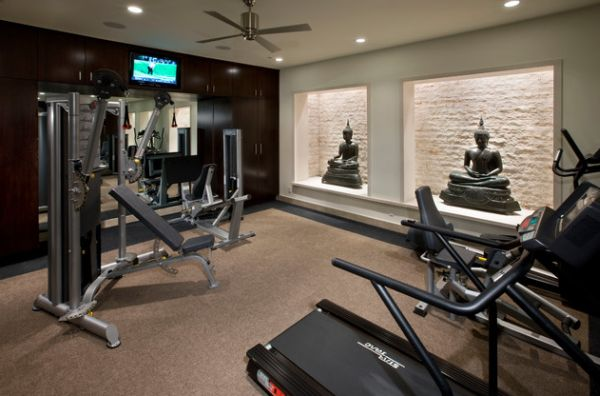 Brilliant home gym with Buddha statues