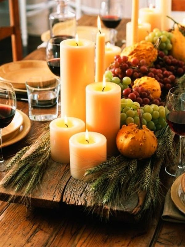 Candles coupled with fall produce on the Thanksgiving table