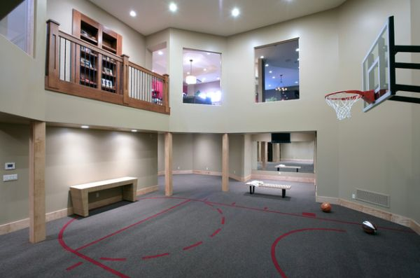 Carpeted indoor basketball court makes for an impressive home gym