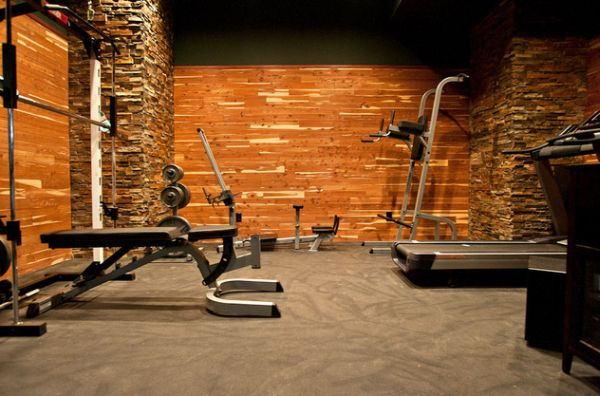 Cedar wall home gym with custom rubber flooring