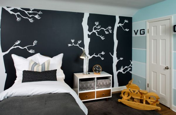 Chalk board paint used to add a stylish black accent wall to the teen bedroom