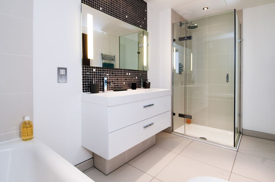 Contemporary bathroom in white and glass shower area