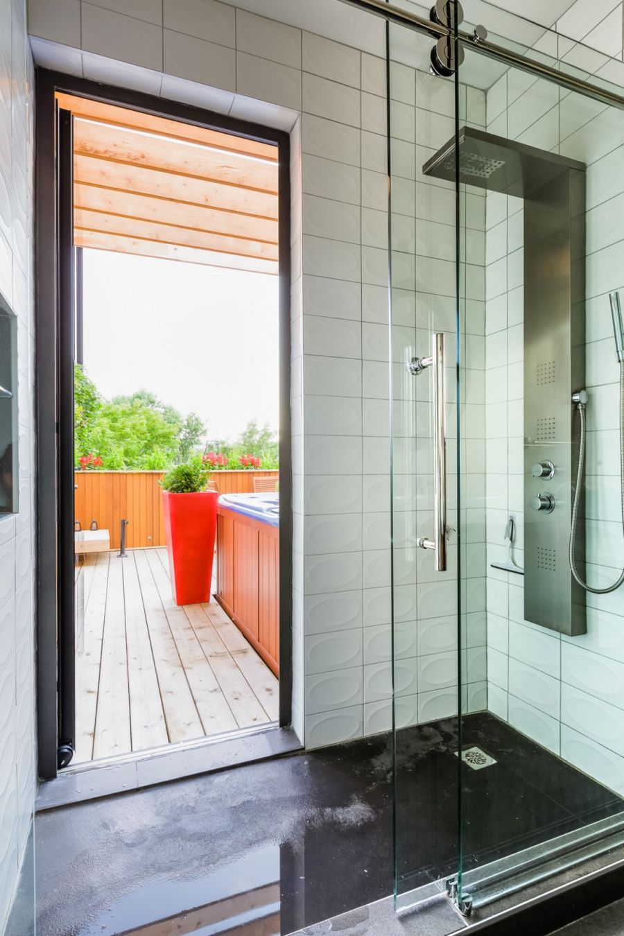 Contemporary bathroom opening up into the terrace with Jacuzzi