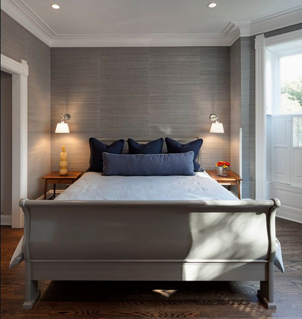 Contemporary bedroom in grey with a stylish sleigh bed