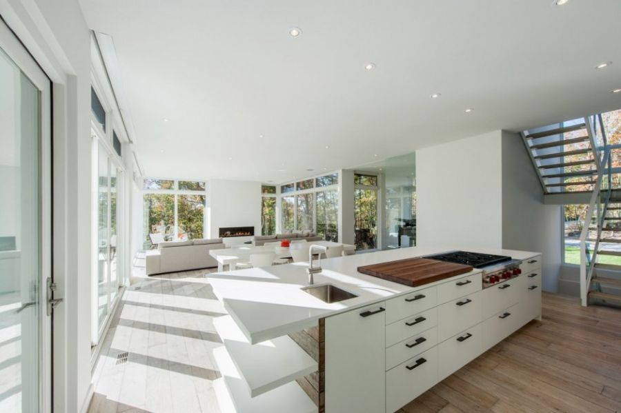 Contemporary kitchen island in white with shelves