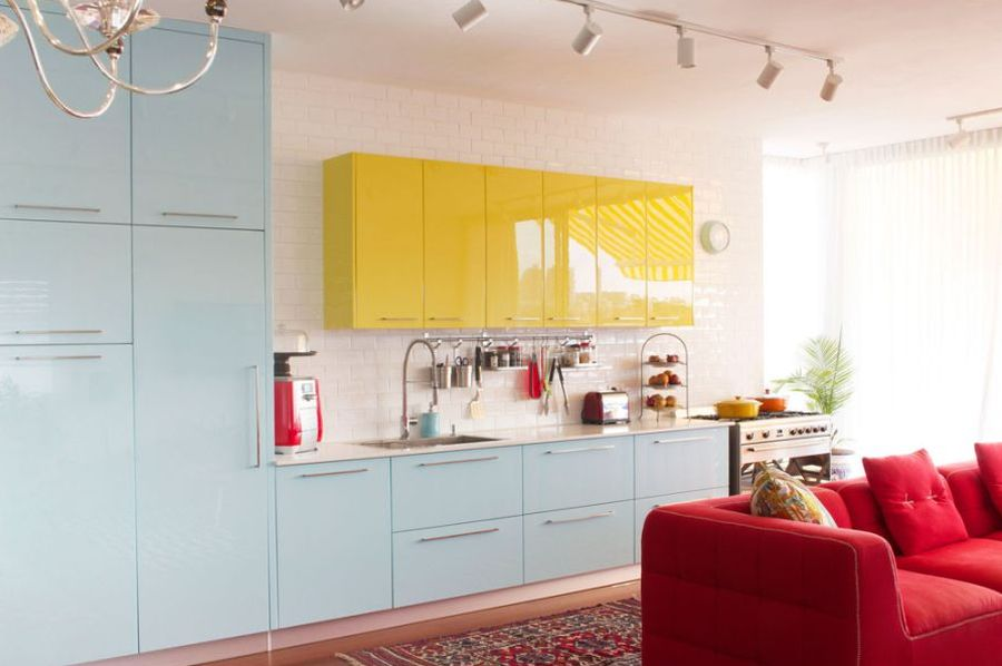 Cool blue and mellow yellow cabinets in the kitchen