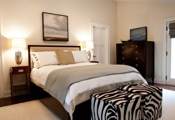 Cube ottomans in zebra print at the foot of the bed give the bedroom a glam makeover