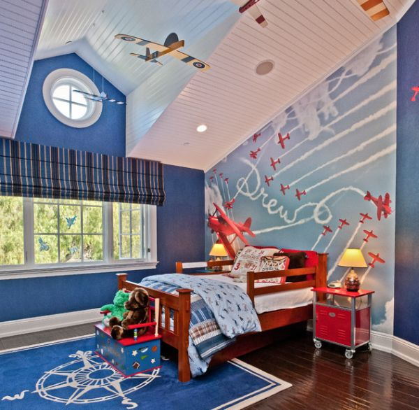 Custom hand-painted mural turns this bedroom into a fun space