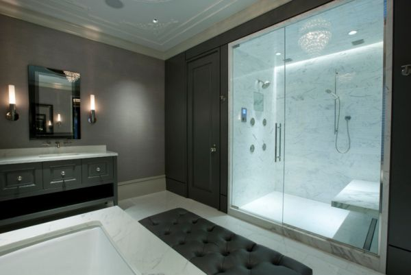 Dark walls give the steam shower clad in Calcutta Gold tiles more visual impact