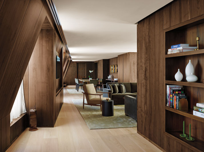 Dark walnut wall paneling inside the suites