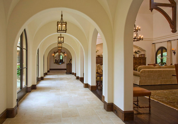 Dramatic lighting in a Mediterranean-style hallway