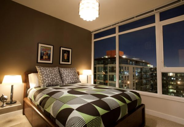 Eclectic bachelor pad bedroom in Vancouver with a view of the city skyline