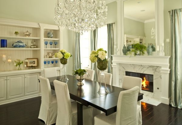 Eclectic dining room with a fireplace and a built-in mirror above it