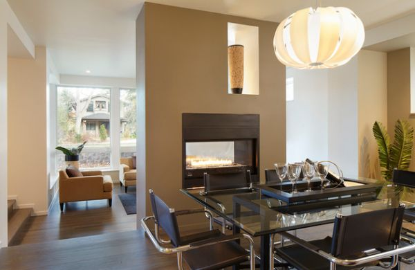 Elegant fireplace warms up both the kitchen and the dining area