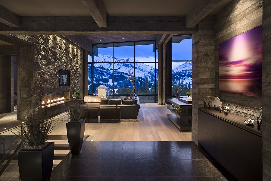 Entry wih a modern fireplace Private Luxury Ski Resort in Montana by Len Cotsovolos