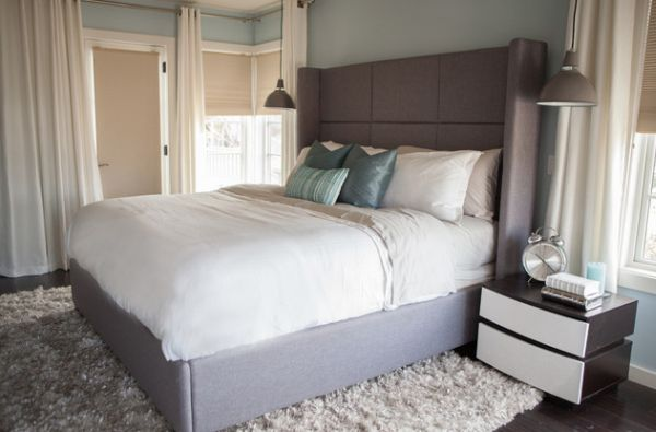 Exaggerated headboard paints a warm and cozy picture!